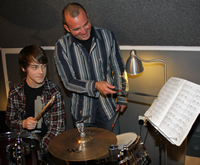 Rossini Cavalcante working with student Forest at the Drum Kit